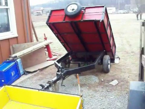 Two home made diy mechanical dump trailers dumping
