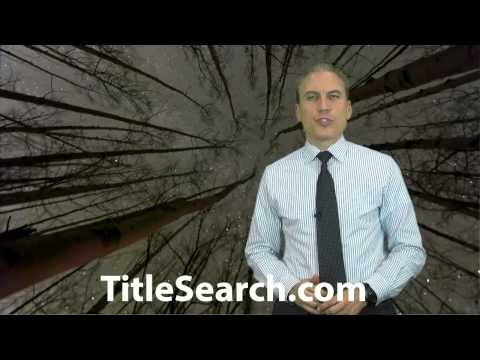How do you find out about liens on a foreclosure property?