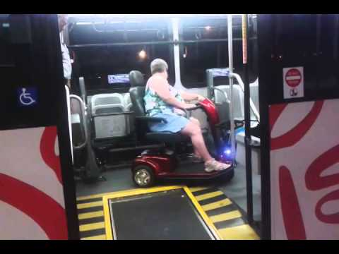 How to park a scooter on a Walt Disney World Bus