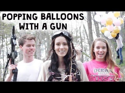 POPPING HAIR BALLOONS WITH A GUN
