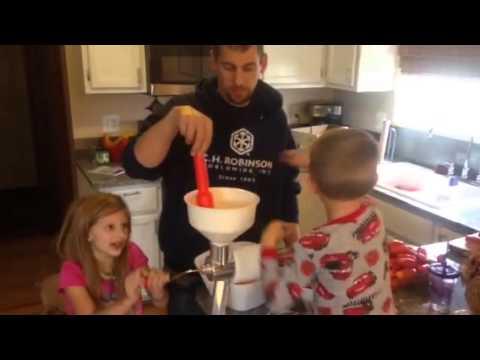Making tomato sauce victorio strainer