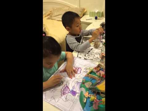 Troy and Megan colouring in books