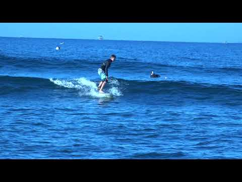 Bully's student 12 year old surfer Slater catching a wave