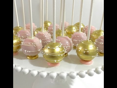 Upside down pink & gold Cakepops with flat bottom base and stripes/swirls design