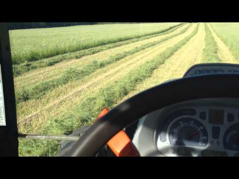 New holland tractor cutting hay