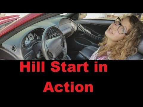 How to drive a manual transmission vehicle on a hill in action