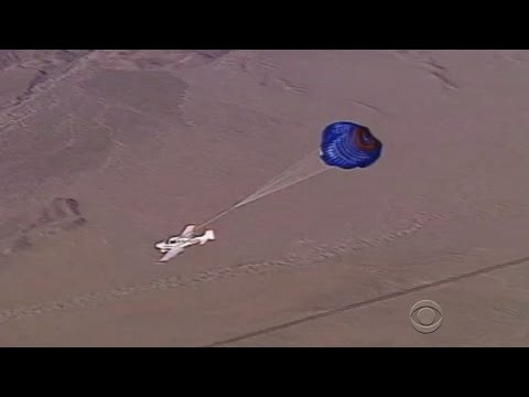 Powerless plane makes parachute landing