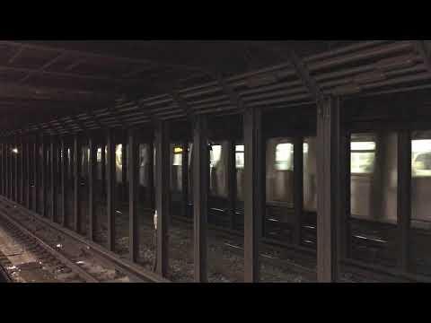 MTA NYC Subway N train passing 8th St/NYU