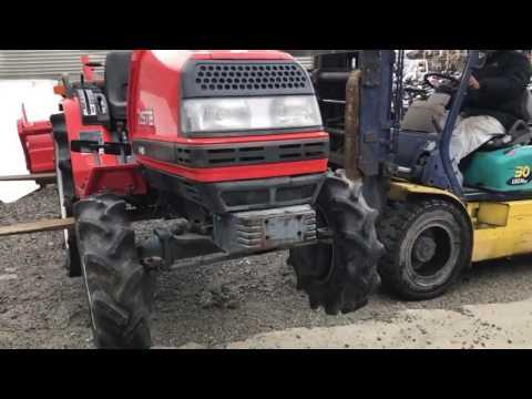 kuboto iseki used japanese tractors exporter supplyer mix with motor bikes. AZ international japan