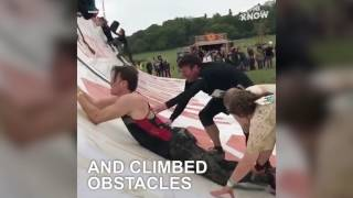 Father Helps Disabled Son Climb a Tough Mudder Obstacle