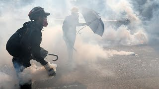 Hong Kong police fire tear gas, clash with protesters