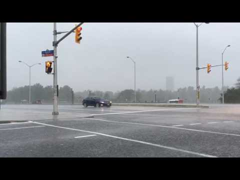 RED LIGHT CAMERA LIGHT FLASHES UNDER POURING RAIN