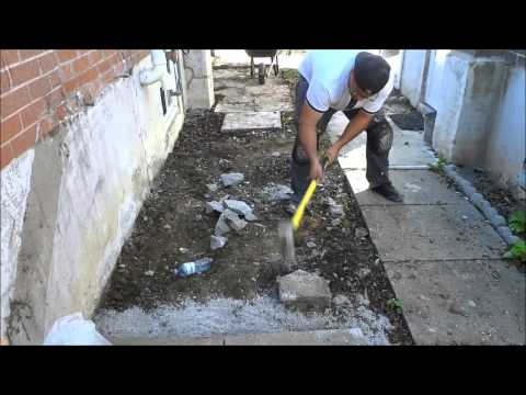 Smashing Cement Footings With A Sledgehammer