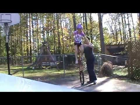 11 year old girl rides 5 foot tall giraffe unicycle