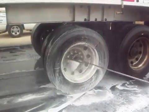 Cleaning Tractor Trailer Aluminum Wheels in Corpus Christi Texas by TruckWashingCorpusChristi.com