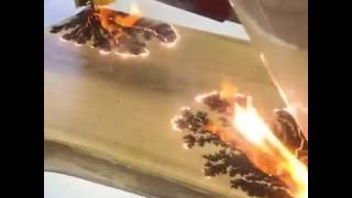 Craftsmen Uses Electricity To Burn Pattern On Wood