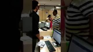 angry old men slap Bank employee in India