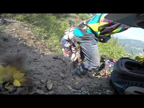 Dirt bike falls of 40 foot cliff