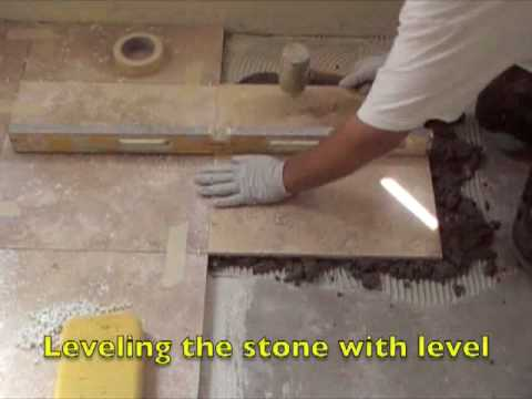 Installing a stone floor using a float method.