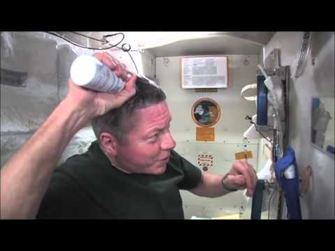 Mike Fossum; washing hair in space