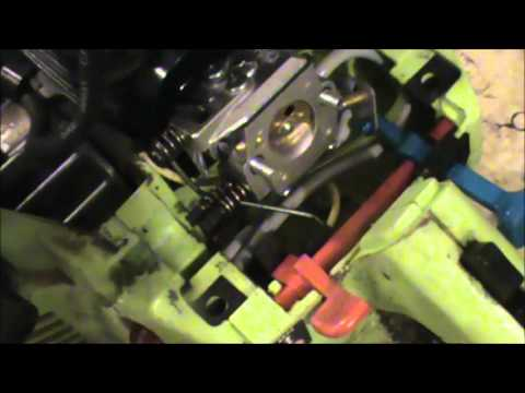 Where do the fuel and primer lines go in a Craftsman or Poulan Chainsaw?
