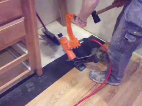 How to install a hardwood floor around cabinets and exterior door