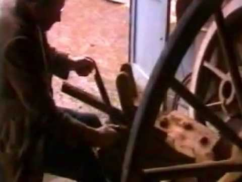 A traditional wood-worker making a cart wheel