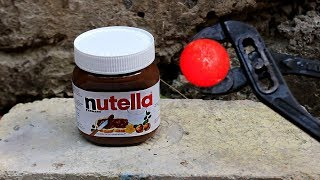 EXPERIMENT: Glowing 700 degree metal ball VS NUTELLA