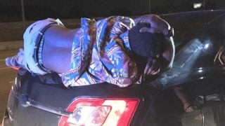 Cop stops driver: Do you know you have a drunk on the trunk?