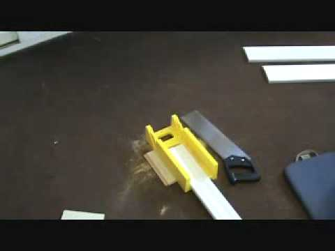 Cutting a door casing with a plastic mitre box & hand saw unit
