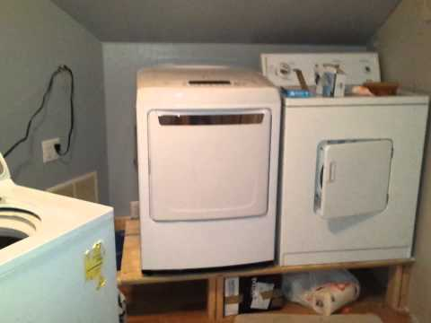 2 washers and 2 dryers in one laundry room