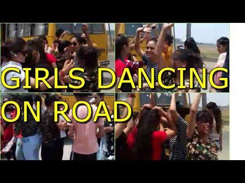 GIRLS DANCING ON ROAD