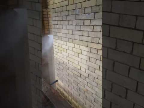 Chemical cleaning of yellow brickwork.