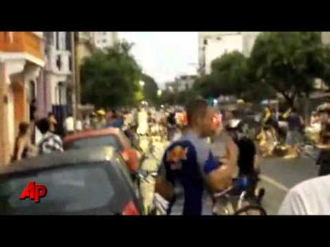 Raw Video: Car Runs Over Bicyclists