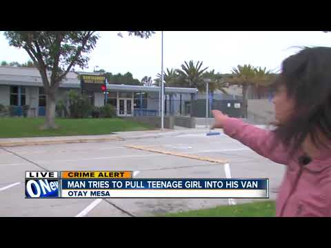 Police search for man accused of trying to force girl into van