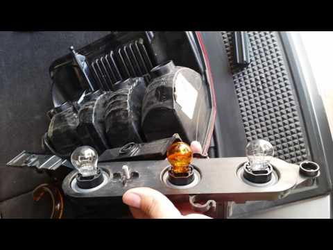 Replace a break light bulb on a Jeep Liberty.