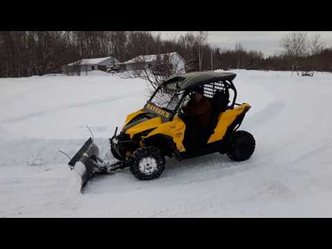 Marverick plowing snow
