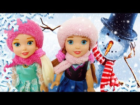 Frozen Anna and Elsa Dolls on a Winter Fairytale Adventure