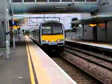 Class 321 train departs from Southend airport station