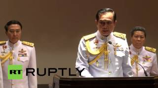 Thailand: General Prayuth Chan-ocha walks off stage after being questioned about elections