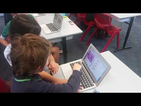 In Kingaroy - our Coding Mentor Ellie competes against student at his own computer game