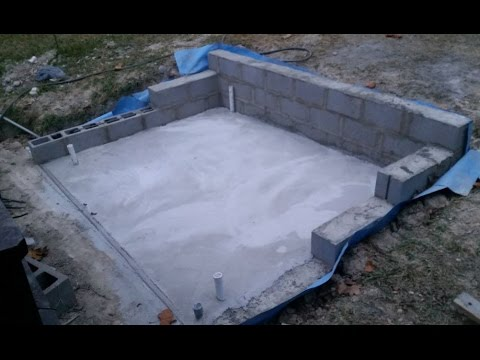 Reinforced Retaining Wall and Concrete pad build