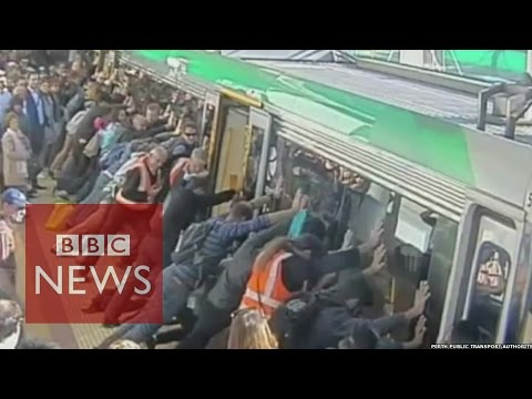 Train rescue: Passengers tilt train to free trapped man in Australia - BBC News