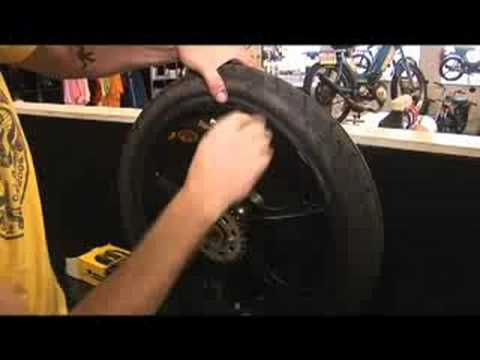 Moped Gangs: How to Change a Tire
