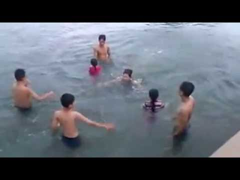 Young women and men bathing naked Vietnam river