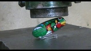 Crushing toy Frog with hydraulic press