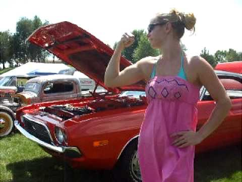 Shelly bicep flex car show american muscle