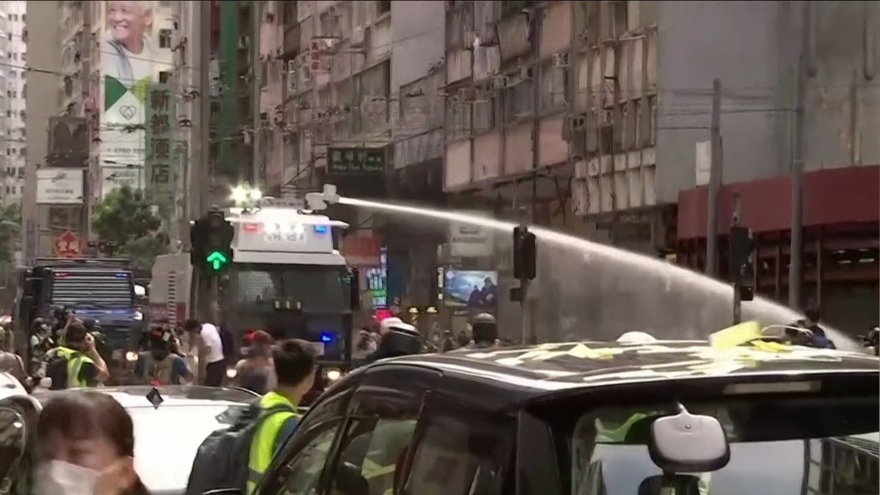 Hong Kong police fire water cannon at protesters as new security law comes into force