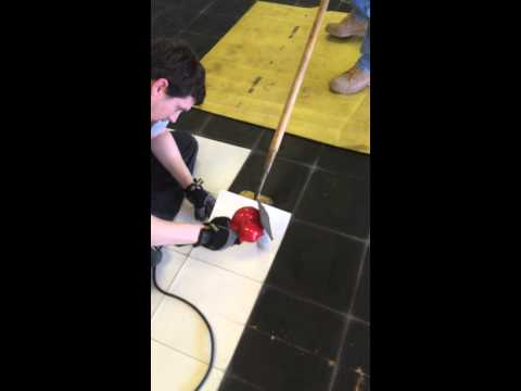 Removing vinyl tile from wood subfloor with heat gun
