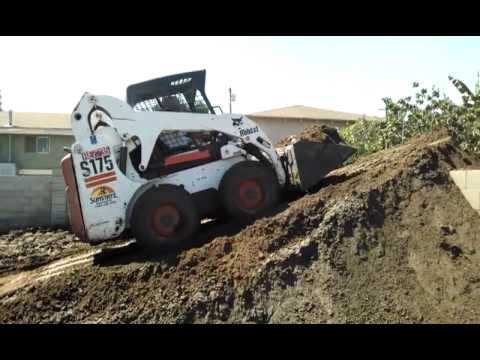 Bobcat building a dirt ramp